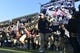 Nov 9, 2013; Annapolis, MD, USA; Navy Midshipmen head coach Ken Niumatalolo and the Navy football team run onto the field prior to the start of the Hawaii Warriors vs Navy Midshipmen game at Navy Marine Corps Memorial Stadium. Mandatory Credit: Tommy Gilligan-USA TODAY Sports