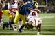 Nov 9, 2013; Ann Arbor, MI, USA; Nebraska Cornhuskers running back Ameer Abdullah (8) dives into the end zone for a touchdown in the fourth quarter against the Michigan Wolverines at Michigan Stadium. Nebraska won 17-13. Mandatory Credit: Rick Osentoski-USA TODAY Sports