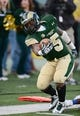 Nov 9, 2013; Fort Collins, CO, USA; Colorado State Rams running back Kapri Bibbs (5) attempts to stay inbounds in the fourth quarter against the Nevada Wolf Pack at Hughes Stadium. The Rams defeated the Wolf Pack 38-17.Mandatory Credit: Ron Chenoy-USA TODAY Sports
