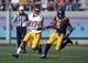Nov 9, 2013; Berkeley, CA, USA; Southern California Trojans tailback Javorious Allen (37) rushes for a 43-yard touchdown in the first quarter as California Golden Bears linebacker Marchael Barton (8) defends at Memorial Stadium. Mandatory Credit: Kirby Lee-USA TODAY Sports