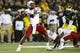Nov 9, 2013; Ann Arbor, MI, USA; Nebraska Cornhuskers quarterback Tommy Armstrong Jr. (4) passes the ball in the third quarter against the Michigan Wolverines at Michigan Stadium. Nebraska won 17-13. Mandatory Credit: Rick Osentoski-USA TODAY Sports