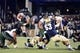Nov 9, 2013; Annapolis, MD, USA; Hawaii Warriors running back Joey Iosefa (7) leaps over a Navy Midshipmen defender as he runs with the ball during the fourth quarter at Navy Marine Corps Memorial Stadium. Navy defeated Hawaii 42-38 Mandatory Credit: Tommy Gilligan-USA TODAY Sports