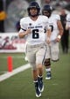 Nov 9, 2013; Las Vegas, NV, USA; Utah State Aggies quarterback Darell Garretson takes to the field for pregame warmups before an NCAA football game against the UNLV Rebels at Sam Boyd Stadium. Mandatory Credit: Stephen R. Sylvanie-USA TODAY Sports