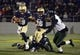 Nov 9, 2013; Annapolis, MD, USA; Navy Midshipmen quarterback Keenan Reynolds (19) breaks free from Hawaii Warriors linebacker Brenden Daley (56) as he runs with the ball during the third quarter at Navy Marine Corps Memorial Stadium. Navy defeated Hawaii 42-38 Mandatory Credit: Tommy Gilligan-USA TODAY Sports