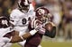 Nov 9, 2013; College Station, TX, USA; Mississippi State Bulldogs defensive lineman Chris Jones (96) attempts to tackle Texas A&M Aggies quarterback Johnny Manziel (2) during the second half at Kyle Field. Texas A&M won 51-41. Mandatory Credit: Thomas Campbell-USA TODAY Sports