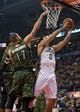 Nov 9, 2013; Toronto, Ontario, CAN; Utah Jazz center Enes Kanter (0) drives to the basket as Toronto Raptors center Jonas Valanciunas (17) goes for the block during the first period in a game at Air Canada Centre. Mandatory Credit: Nick Turchiaro-USA TODAY Sports