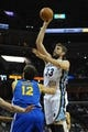 Nov 9, 2013; Memphis, TN, USA; Memphis Grizzlies center Marc Gasol (33) shoots the ball against Golden State Warriors center Andrew Bogut (12) during the first quarter at FedExForum. Mandatory Credit: Justin Ford-USA TODAY Sports