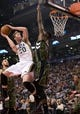 Nov 9, 2013; Toronto, Ontario, CAN; Utah Jazz shooting guard Gordon Hayward (20) drives the ball to the basket as Toronto Raptors power forward Amir Johnson (15) goes for the block during a game at Air Canada Centre. Mandatory Credit: Nick Turchiaro-USA TODAY Sports