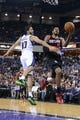 November 9, 2013; Sacramento, CA, USA; Portland Trail Blazers power forward LaMarcus Aldridge (12) drives to the basket against Sacramento Kings point guard Greivis Vasquez (10) during the first quarter at Sleep Train Arena. Mandatory Credit: Kyle Terada-USA TODAY Sports