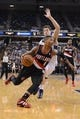 November 9, 2013; Sacramento, CA, USA; Portland Trail Blazers point guard Damian Lillard (0) dribbles the basketball against Sacramento Kings point guard Jimmer Fredette (7, back) during the second quarter at Sleep Train Arena. Mandatory Credit: Kyle Terada-USA TODAY Sports