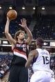 November 9, 2013; Sacramento, CA, USA; Portland Trail Blazers center Robin Lopez (42) shoots the basketball against Sacramento Kings center DeMarcus Cousins (15) during the second quarter at Sleep Train Arena. Mandatory Credit: Kyle Terada-USA TODAY Sports