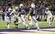 Nov 9, 2013; Seattle, WA, USA; Washington Huskies quarterback Keith Price (17) scores a touchdown against the Colorado Buffaloes during the 2nd half at Husky Stadium. Washington defeated Colorado 59-7. Mandatory Credit: Steven Bisig-USA TODAY Sports