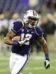 Nov 9, 2013; Seattle, WA, USA; Washington Huskies running back Dwayne Washington (12) carries the ball against the Colorado Buffaloes during the 2nd half at Husky Stadium. Washington defeated Colorado 59-7. Mandatory Credit: Steven Bisig-USA TODAY Sports