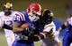 Nov 9, 2013; Ruston, LA, USA; Louisiana Tech Bulldogs running back Kenneth Dixon (28) is tackled by Southern Miss Golden Eagles defensive back Kelsey Douglas (6) during the second half at Joe Aillet Stadium. Mandatory Credit: Chuck Cook-USA TODAY Sports