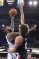 November 9, 2013; Sacramento, CA, USA; Sacramento Kings center DeMarcus Cousins (15, left) shoots the basketball against Portland Trail Blazers center Robin Lopez (42) during the third quarter at Sleep Train Arena. The Trail Blazers defeated the Kings 96-85. Mandatory Credit: Kyle Terada-USA TODAY Sports