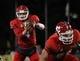 Nov 9, 2013; Laramie, WY, USA; Fresno State Bulldogs quarterback Derek Carr (4) takes the snap from center Lars Bramer (56) against the Wyoming Cowboys during the third quarter at War Memorial Stadium. Mandatory Credit: Troy Babbitt-USA TODAY Sports
