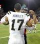 Nov 9, 2013; Tucson, AZ, USA; UCLA Bruins quarterback Brett Hundley (17) and Arizona Wildcats quarterback B.J. Denker (7) hug after the fourth quarter at Arizona Stadium. UCLA beat Arizona 31-26. Mandatory Credit: Casey Sapio-USA TODAY Sports