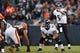 Nov 3, 2013; Cleveland, OH, USA; Baltimore Ravens quarterback Joe Flacco (5) gets set to run a play against the Cleveland Browns at FirstEnergy Stadium. Mandatory Credit: Rick Osentoski-USA TODAY Sports