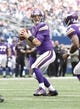 Nov 3, 2013; Arlington, TX, USA; Minnesota Vikings quarterback Christian Ponder (7) looks to throw a pass during the game Dallas Cowboys at AT&T Stadium. Dallas beat Minnesota 27-23. Mandatory Credit: Tim Heitman-USA TODAY Sports