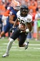 Nov 2, 2013; Syracuse, NY, USA; Wake Forest Demon Deacons wide receiver Sherman Ragland III (26) runs after making a catch during the second quarter of a game against the Syracuse Orange at the Carrier Dome. Mandatory Credit: Mark Konezny-USA TODAY Sports