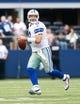 Nov 3, 2013; Arlington, TX, USA; Dallas Cowboys quarterback Tony Romo (9) rolls out to pass during the game against the Minnesota Vikings  at AT&T Stadium. Dallas beat Minnesota 27-23. Mandatory Credit: Tim Heitman-USA TODAY Sports