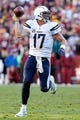 Nov 3, 2013; Landover, MD, USA; San Diego Chargers quarterback Philip Rivers (17) runs with the ball against the Washington Redskins at FedEx Field. Mandatory Credit: Geoff Burke-USA TODAY Sports