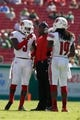 Oct 26, 2013; Tampa, FL, USA; Louisville Cardinals head coach Charlie Strong talks with cornerback Terell Floyd (19) and cornerback Charles Gaines (3) during the second half against the South Florida Bulls at Raymond James Stadium. Mandatory Credit: Kim Klement-USA TODAY Sports