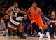 Nov 10, 2013; New York, NY, USA;  New York Knicks small forward Metta World Peace (51) drives past San Antonio Spurs small forward Kawhi Leonard (2) during the third quarter at Madison Square Garden. Spurs won 120-89.  Mandatory Credit: Anthony Gruppuso-USA TODAY Sports