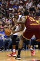 Nov 8, 2013; Philadelphia, PA, USA; Philadelphia 76ers forward Thaddeus Young (21) is defended by Cleveland Cavaliers forward Tristan Thompson (13) during the first quarter at Wells Fargo Center. The Sixers defeated the Cavaliers 94-79. Mandatory Credit: Howard Smith-USA TODAY Sports