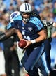 Nov 10, 2013; Nashville, TN, USA; Tennessee Titans quarterback Ryan Fitzpatrick (4) drops back into the pocket against the Jacksonville Jaguars during the second half at LP Field. The Jaguars beat the Titans 29-27. Mandatory Credit: Don McPeak-USA TODAY Sports