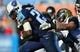 Nov 10, 2013; Nashville, TN, USA; Tennessee Titans running back Chris Johnson (28) is tackled by Jacksonville Jaguars linebacker Paul Posluszny (51) during the second half at LP Field. The Jaguars beat the Titans 29-27. Mandatory Credit: Don McPeak-USA TODAY Sports