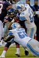 Nov 10, 2013; Chicago, IL, USA;  Chicago Bears running back Matt Forte (22) gets tackeled by Detroit Lions outside linebacker DeAndre Levy (54) and Detroit Lions middle linebacker Stephen Tulloch (55) at Soldier Field. Mandatory Credit: Matt Marton-USA TODAY Sports