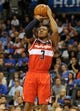 Nov 10, 2013; Oklahoma City, OK, USA; Washington Wizards shooting guard Bradley Beal (3) attempts a shot against the Oklahoma City Thunder during the second quarter at Chesapeake Energy Arena. Mandatory Credit: Mark D. Smith-USA TODAY Sports