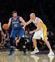 Nov 10, 2013; Los Angeles, CA, USA;  Los Angeles Lakers center Chris Kaman (9) guards Minnesota Timberwolves power forward Kevin Love (42) in the second half of the game at Staples Center. Timberwolves won 113-90. Mandatory Credit: Jayne Kamin-Oncea-USA TODAY Sports