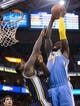 Nov 11, 2013; Salt Lake City, UT, USA; Denver Nuggets power forward J.J. Hickson (7) dunks over Utah Jazz power forward Marvin Williams (2) during the first half at EnergySolutions Arena. Mandatory Credit: Russ Isabella-USA TODAY Sports
