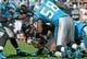 Nov 3, 2013; Charlotte, NC, USA; Atlanta Falcons running back Steven Jackson (39) gets stopped by Carolina Panthers linebacker Thomas Davis (58) during the game at Bank of America Stadium. Carolina win 34-10. Mandatory Credit: Sam Sharpe-USA TODAY Sports