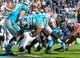 Nov 3, 2013; Charlotte, NC, USA; Carolina Panthers fullback Mike Tolbert (35) scores a touchdown during the game against the Atlanta Falcons at Bank of America Stadium. Panthers win 34-10. Mandatory Credit: Sam Sharpe-USA TODAY Sports