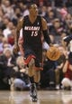 Nov 5, 2013; Toronto, Ontario, CAN; Miami Heat point guard Mario Chalmers (15) brings the ball up the court against the Toronto Raptors at Air Canada Centre. The Heat beat the Raptors 104-95. Mandatory Credit: Tom Szczerbowski-USA TODAY Sports