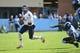 Nov 9, 2013; Chapel Hill, NC, USA; Virginia Cavaliers quarterback David Watford (5) runs as North Carolina Tar Heels defensive end Kareem Martin (95) and defensive tackle Tim Jackson (93) defend in the first quarter at Kenan Memorial Stadium. Mandatory Credit: Bob Donnan-USA TODAY Sports