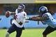 Nov 9, 2013; Chapel Hill, NC, USA; Virginia Cavaliers quarterback David Watford (5) runs as North Carolina Tar Heels defensive tackle Tim Jackson (93) defends in the first quarter at Kenan Memorial Stadium. Mandatory Credit: Bob Donnan-USA TODAY Sports