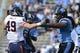 Nov 9, 2013; Chapel Hill, NC, USA; Virginia Cavaliers tight end Zachary Swanson (49) and North Carolina Tar Heels defensive tackle Tim Jackson (93) react in the first quarter at Kenan Memorial Stadium. Mandatory Credit: Bob Donnan-USA TODAY Sports