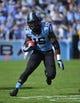 Nov 9, 2013; Chapel Hill, NC, USA; North Carolina Tar Heels running back A.J. Blue (15) runs in the first quarter at Kenan Memorial Stadium. Mandatory Credit: Bob Donnan-USA TODAY Sports