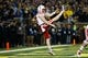 Nov 9, 2013; Ann Arbor, MI, USA; Nebraska Cornhuskers punter Sam Foltz (27) punts the ball against the Nebraska Cornhuskers at Michigan Stadium. Mandatory Credit: Rick Osentoski-USA TODAY Sports