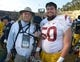 Nov 9, 2013; Berkeley, CA, USA; Southern California Trojans guard Abe Markowitz (50) poses with his father Barry Markowitz after the game against the California Golden Bears at Memorial Stadium. USC defeated California 62-28. Mandatory Credit: Kirby Lee-USA TODAY Sports