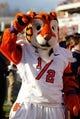 "Nov 2, 2013; Charlottesville, VA, USA; Clemson Tigers mascot ""1/2 cub"" cheers on the sidelines against the Virginia Cavaliers at Scott Stadium. Mandatory Credit: Geoff Burke-USA TODAY Sports"
