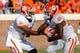 Nov 2, 2013; Charlottesville, VA, USA; Clemson Tigers quarterback Tajh Boyd (10) hands the ball off to Tigers running back Roderick McDowell (25) against the Virginia Cavaliers at Scott Stadium. Mandatory Credit: Geoff Burke-USA TODAY Sports