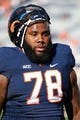 Nov 2, 2013; Charlottesville, VA, USA; Virginia Cavaliers offensive tackle Morgan Moses (78) stands on the field prior to the Cavaliers game against the Clemson Tigers at Scott Stadium. Mandatory Credit: Geoff Burke-USA TODAY Sports