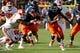 Nov 2, 2013; Charlottesville, VA, USA; Virginia Cavaliers quarterback David Watford (5) carries the ball against the Clemson Tigers at Scott Stadium. Mandatory Credit: Geoff Burke-USA TODAY Sports
