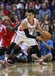 Nov 9, 2013; Houston, TX, USA; Houston Rockets point guard Jeremy Lin (7) controls the ball during the third quarter against the Los Angeles Clippers at Toyota Center. Mandatory Credit: Troy Taormina-USA TODAY Sports
