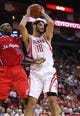 Nov 9, 2013; Houston, TX, USA; Houston Rockets small forward Omri Casspi (18) gets a rebound during the third quarter as Los Angeles Clippers shooting guard Jamal Crawford (11) defends at Toyota Center. Mandatory Credit: Troy Taormina-USA TODAY Sports